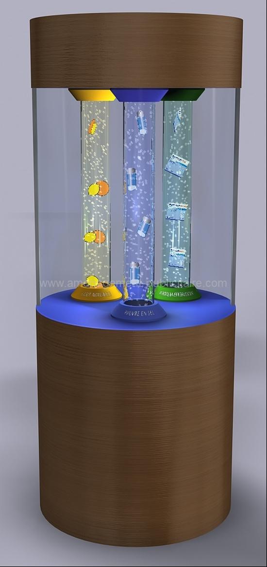 mobilier pour magasin - borne publicitaire composé d'un support cylindrique et de trois tubes dans lesquels circulent les produits mis en valeur en flottant dans l'eau.